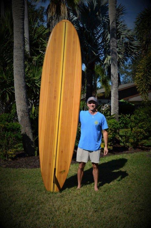 Ken Marvel with handmade paddleboard