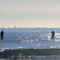 Randy and friend on ocean surf SUPs