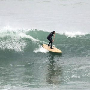 Randy Bogardus riding his own handmade ocean surfboard SUP